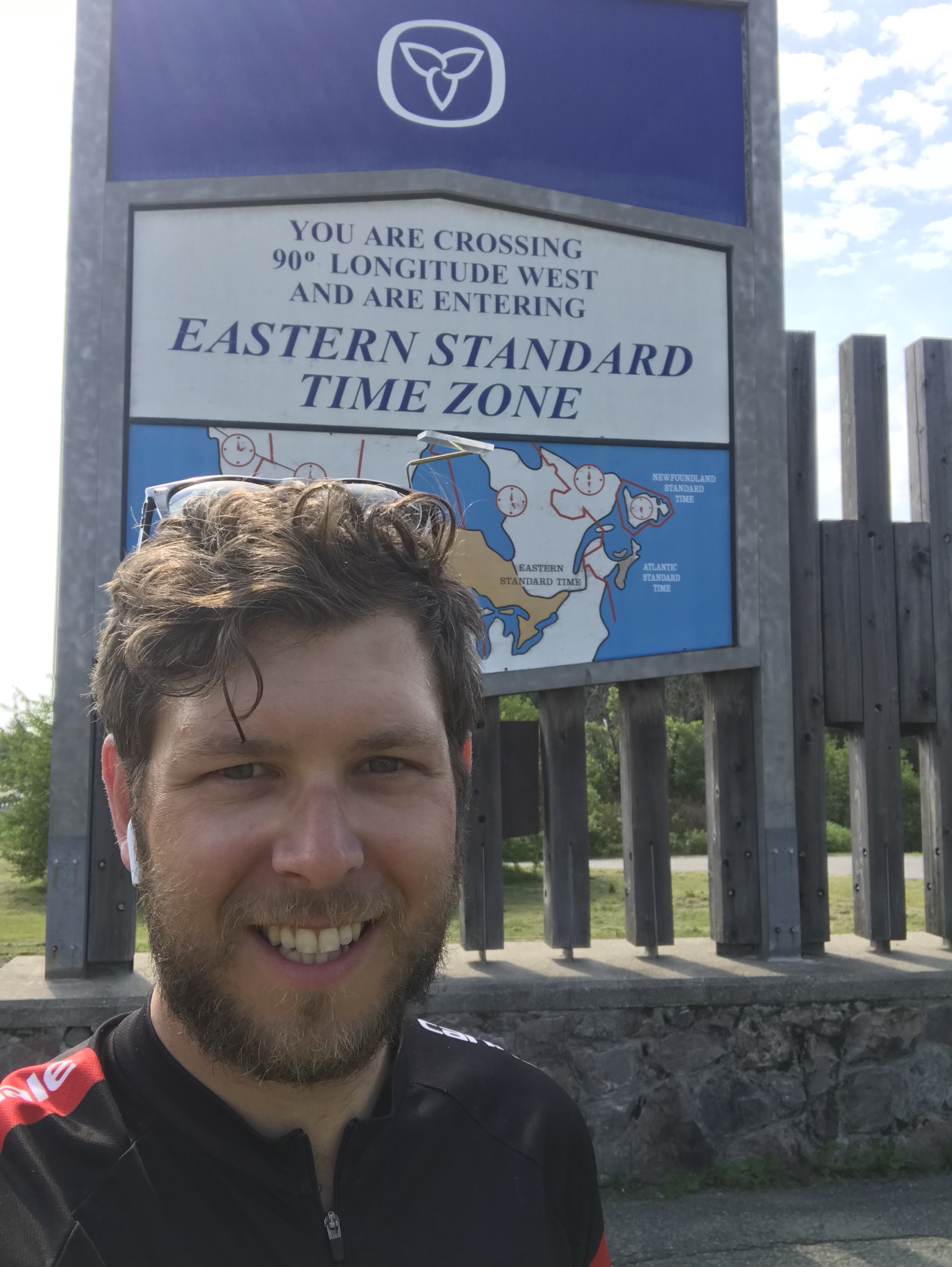 Ben standing in front of the Eastern time zone sign