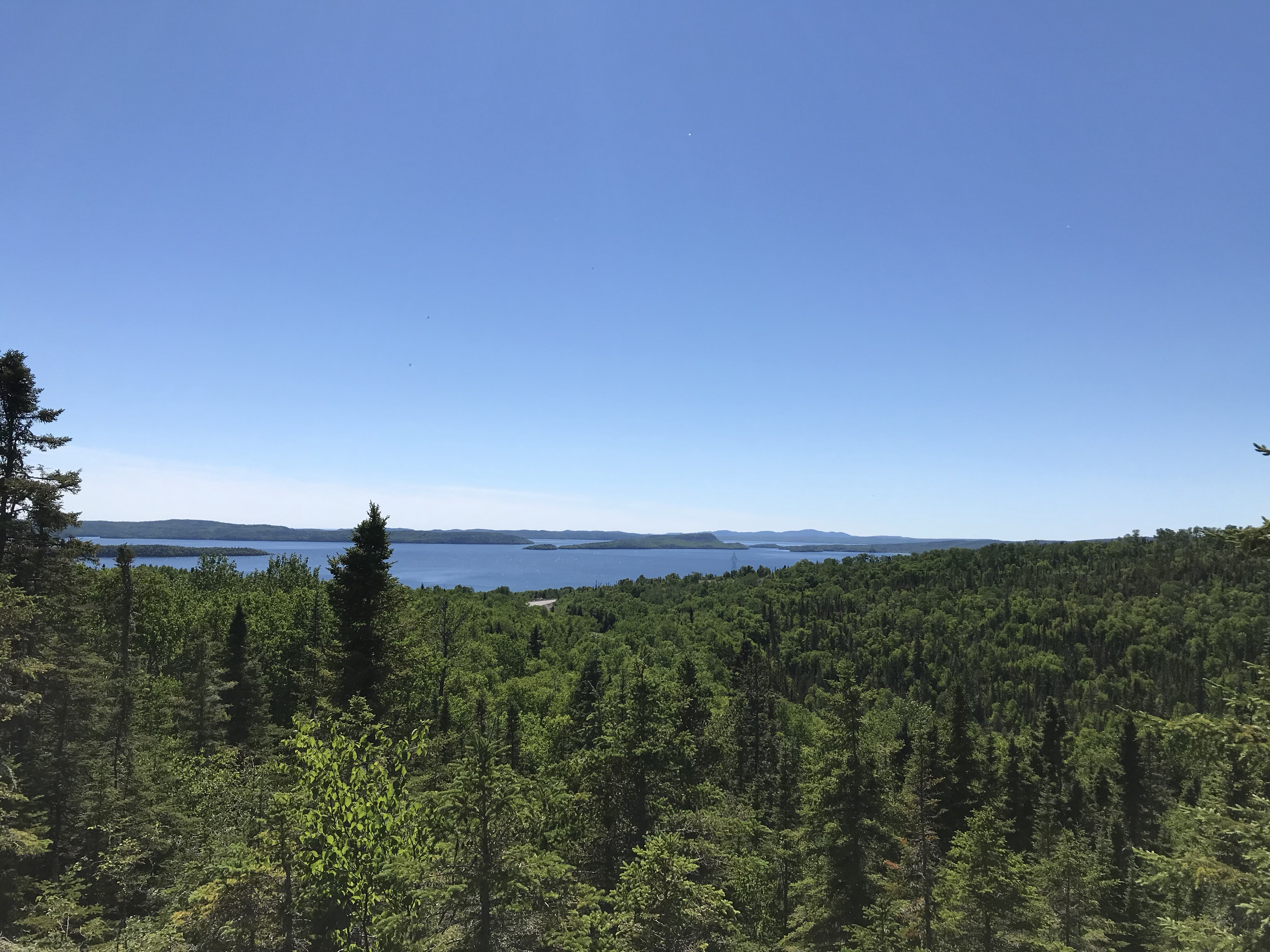 A view of Nipigon Bay from atop a hill with islands in the background